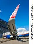 modern civil aircraft under...   Shutterstock . vector #748985563