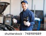 portrait of an auto mechanic...   Shutterstock . vector #748989889