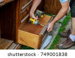 a workman fixing cabinet with...   Shutterstock . vector #749001838