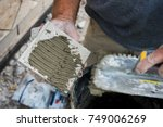 mortar being applied to a tile... | Shutterstock . vector #749006269