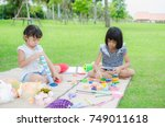 asian child happy play toy in... | Shutterstock . vector #749011618