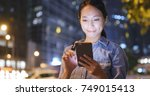 woman using mobile phone with... | Shutterstock . vector #749015413