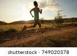 young trail runner woman... | Shutterstock . vector #749020378