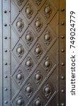 embossed pattern on a bronze... | Shutterstock . vector #749024779