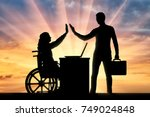 worker woman a disabled person... | Shutterstock . vector #749024848
