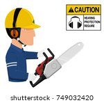 a worker with earmuffs is using ... | Shutterstock .eps vector #749032420