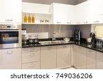 modern kitchen furniture with... | Shutterstock . vector #749036206
