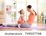 mother and child daughter are... | Shutterstock . vector #749037748