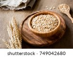 rolled oats  organic oat flakes ...   Shutterstock . vector #749042680