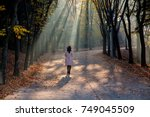 Woman Walking On Misty Autumn...