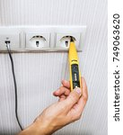 electrician testing for... | Shutterstock . vector #749063620