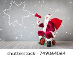 santa claus riding bicycle.... | Shutterstock . vector #749064064