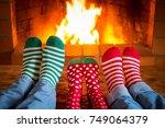 family in christmas socks near... | Shutterstock . vector #749064379