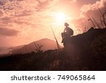 hiker sitting on mountain ...   Shutterstock . vector #749065864