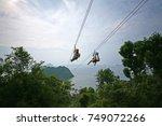 ziplining on a zip wire... | Shutterstock . vector #749072266