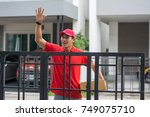 delivery man with parcel in... | Shutterstock . vector #749075710