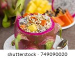 fresh tropical fruit salad with ... | Shutterstock . vector #749090020