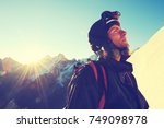 climber  reaches the summit of... | Shutterstock . vector #749098978