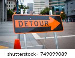 A Detour Sign Directs Traffic...