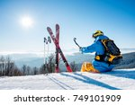 rearview view of a skier with... | Shutterstock . vector #749101909