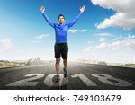 young asian man running with... | Shutterstock . vector #749103679