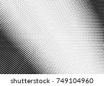 abstract halftone dotted grunge ... | Shutterstock .eps vector #749104960