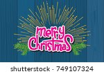merry christmas text with hand...   Shutterstock .eps vector #749107324