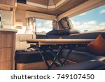 Travel Trailer RV Dining Area. Elegant Recreational Vehicle Interior. - stock photo