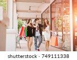 asian friends spending time... | Shutterstock . vector #749111338