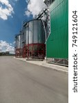 Small photo of Modern large granary. Large metal silos. Sunny day, the blue sky.