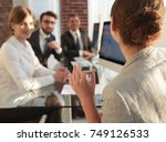 business woman conducts a... | Shutterstock . vector #749126533