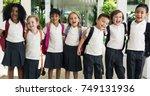 happy kids at elementary school | Shutterstock . vector #749131936