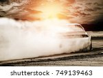 Stock photo abstract blurred drift cars with smoke from burned tire at sunset 749139463