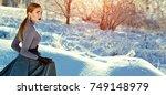 beautiful young girl in a long... | Shutterstock . vector #749148979