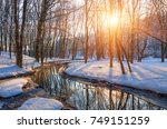 river flowing through the snow... | Shutterstock . vector #749151259
