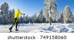 a woman cross country skiing in ... | Shutterstock . vector #749158060