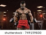 handsome man with big muscles ... | Shutterstock . vector #749159830