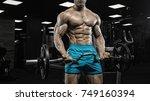 man in gym. muscular... | Shutterstock . vector #749160394