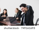 troubled businessman in meeting ... | Shutterstock . vector #749161693