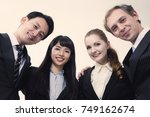 smiling group of businessperson. | Shutterstock . vector #749162674