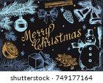 handwritten inscription merry... | Shutterstock .eps vector #749177164