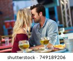 couple kissing while on date at ... | Shutterstock . vector #749189206