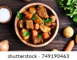 meat stew with vegetables in... | Shutterstock . vector #749190463