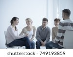 smiling girl talking about her... | Shutterstock . vector #749193859