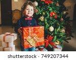 little boy with christmas... | Shutterstock . vector #749207344