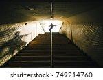 guy sliding of the railing in... | Shutterstock . vector #749214760