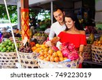 couple buying exotic fruits at... | Shutterstock . vector #749223019