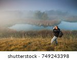 man is hiking and watching... | Shutterstock . vector #749243398