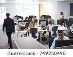 man walking through a busy open ... | Shutterstock . vector #749250490