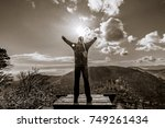 Man Stands On The Mountain And...